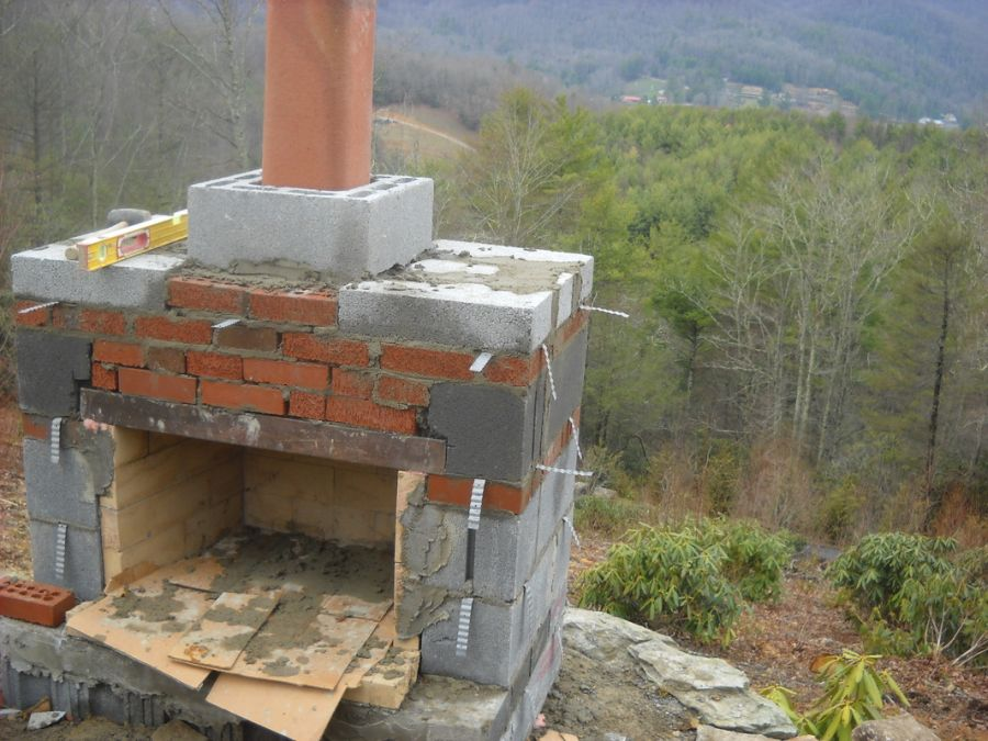 How to build an outdoor stone fireplace step by step for Building outside design