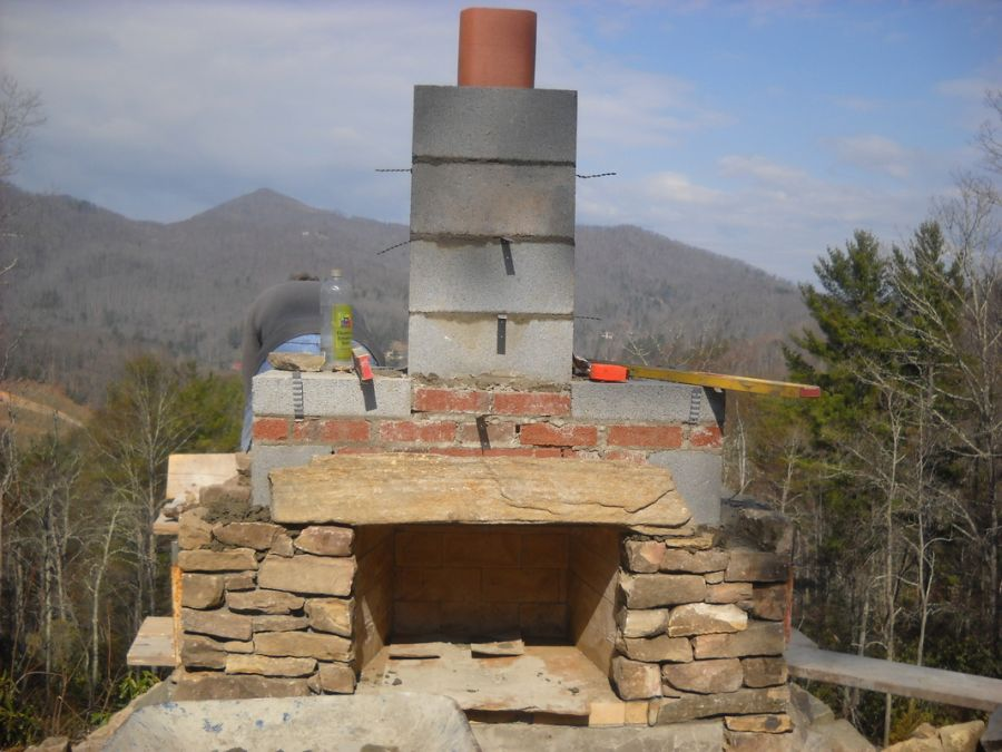 How to build an outdoor stone fireplace in the garden