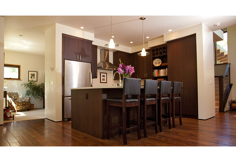 Interior shot of the kitchen. Mountain, modern interior design. Wood floors and custom cabinetry.