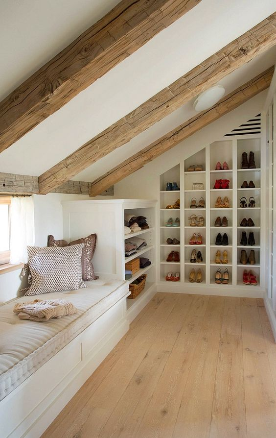 A small attic which makes room to an intimate a nesting place with many storage spaces seamlessly integrated. Wood beams and floor line the plane on two ... & 16 Small Attic Room Design Ideas - Houz Buzz