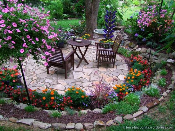 A Raised Corner Of The Garden And Bordered By A Stone Wall Again. It Looks  Like A Genuine Natural Fortress In Which Flowers Of Different Colors And ...